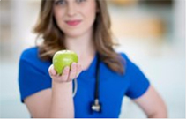 Nurse holding green apple.