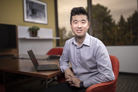 man sitting sitting in an office facing at the camera