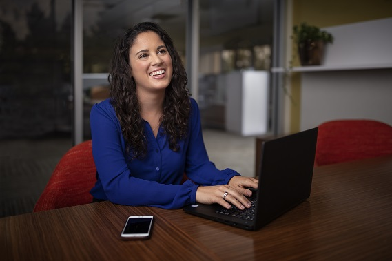 woman typing and smiling