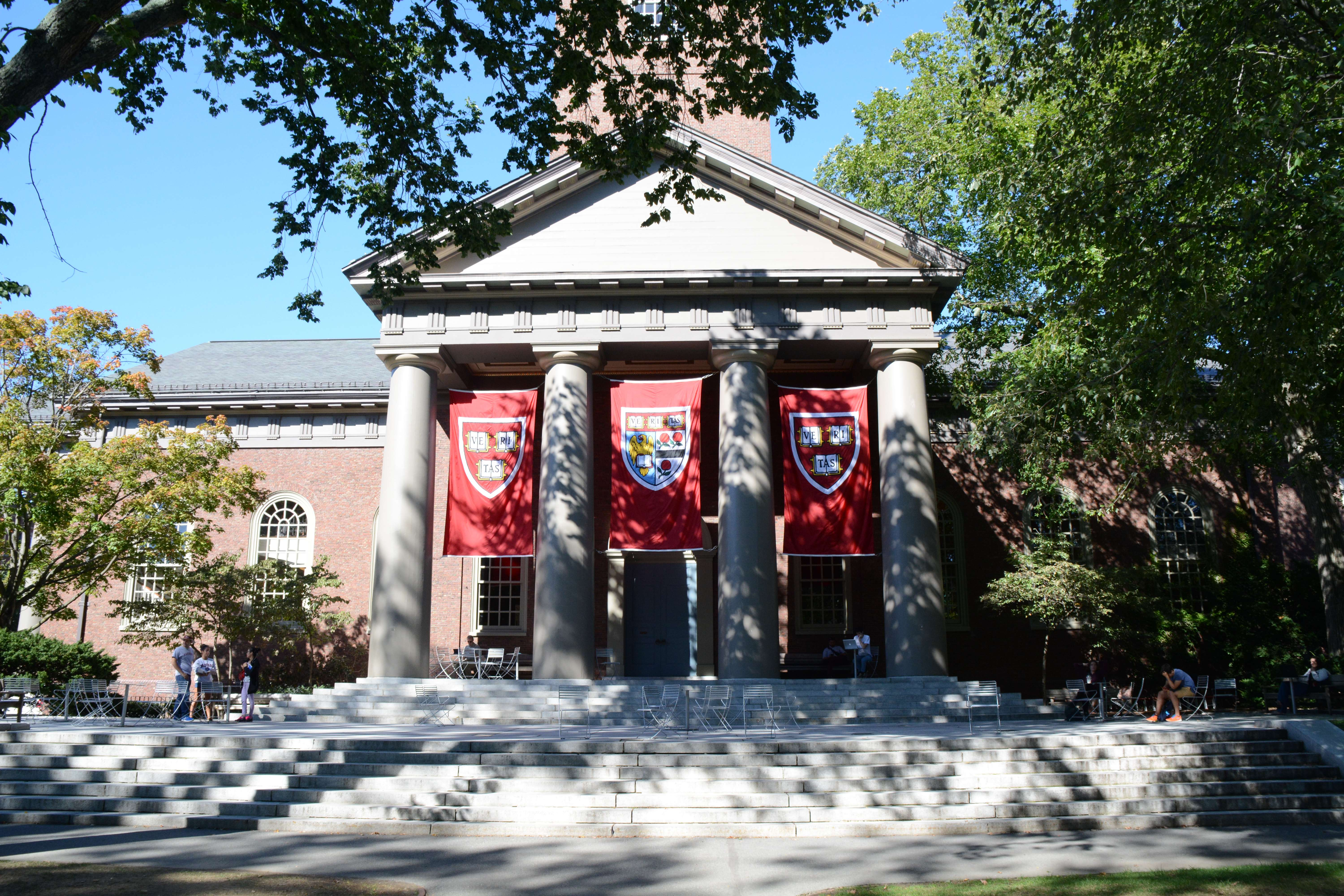 A building with harvard flags